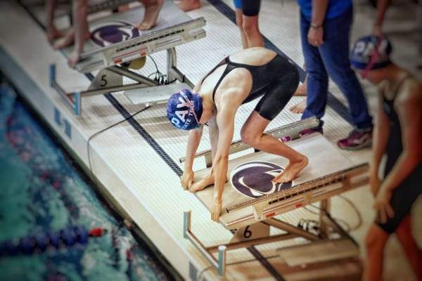 Kenzie swimming at States